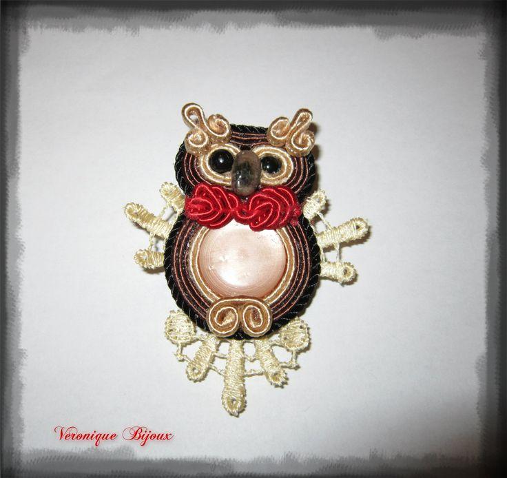 A small owl soutache.
