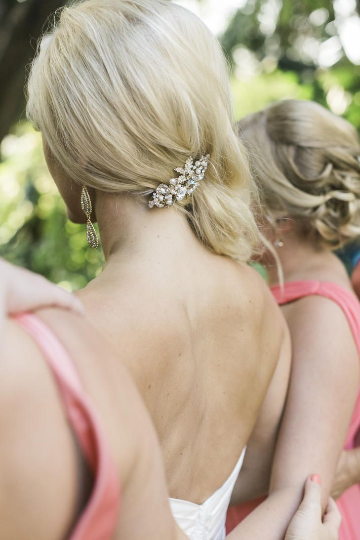 This elegant side swept hairstyle, paired with a vintage hair clip, is perfect for showing off the back of your wedding dress.