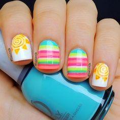 Fun tropical colored stripes and spiral suns nail art - Super Cute!