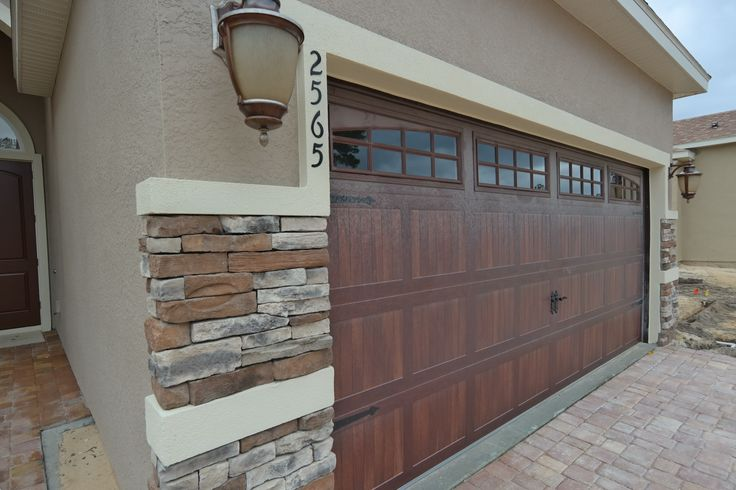 Michelangelo faux wood garage door michelangelo for Faux painted garage doors