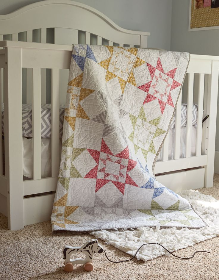 SUDOKU by Stacey Day: Like the popular Japanese puzzle, these star quilt blocks are based on a square grid layout. A  Scandinavian-inspired fabric collection was used to construct the Star-in-a-Star quilt blocks and Flying Geese units, in two sizes, making quick work of piecing.