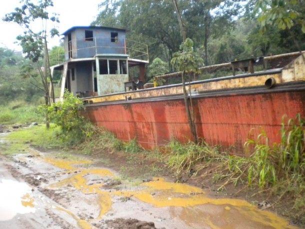 Abandoned boat on the bank of the Rio Igauzu Argentina