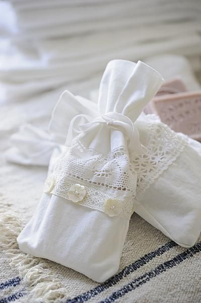 Small sachets decorated with lace and buttons and filled with French soap (or herbs).