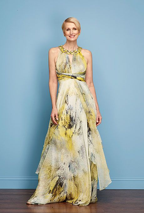 Brides: Mom's Wedding Wardrobe. The painterly blue-and-yellow print on this silk-chiffon dress couldn't be more hip, while the high waist and layered skirt cleverly camouflage any lumps and bumps. The jeweled collar draws the eye up%u2014perfect for showing off a toned top half; $790, Rickie Freeman for Teri Jon.