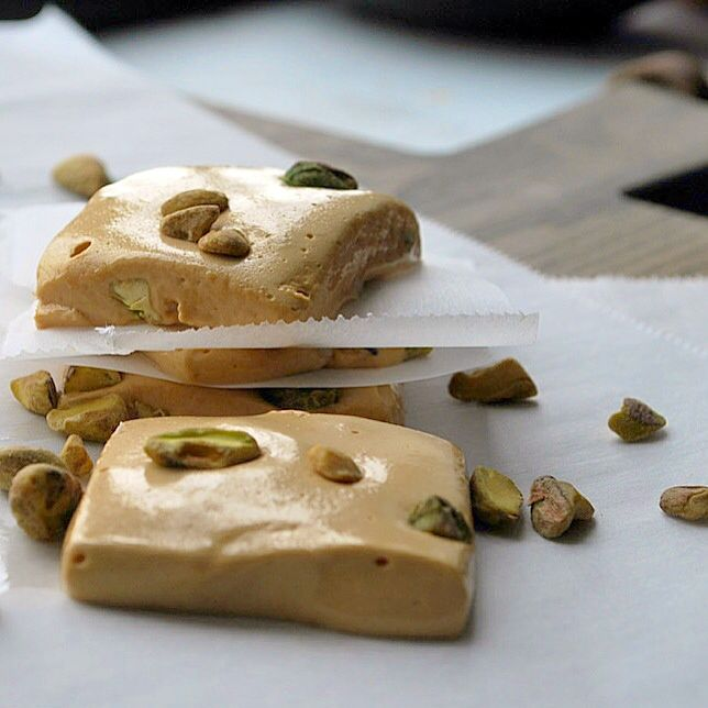 Gaz, a classic Persian candy that's chewy, sweet, floral and studded with pistachios or the nuts of your choice.