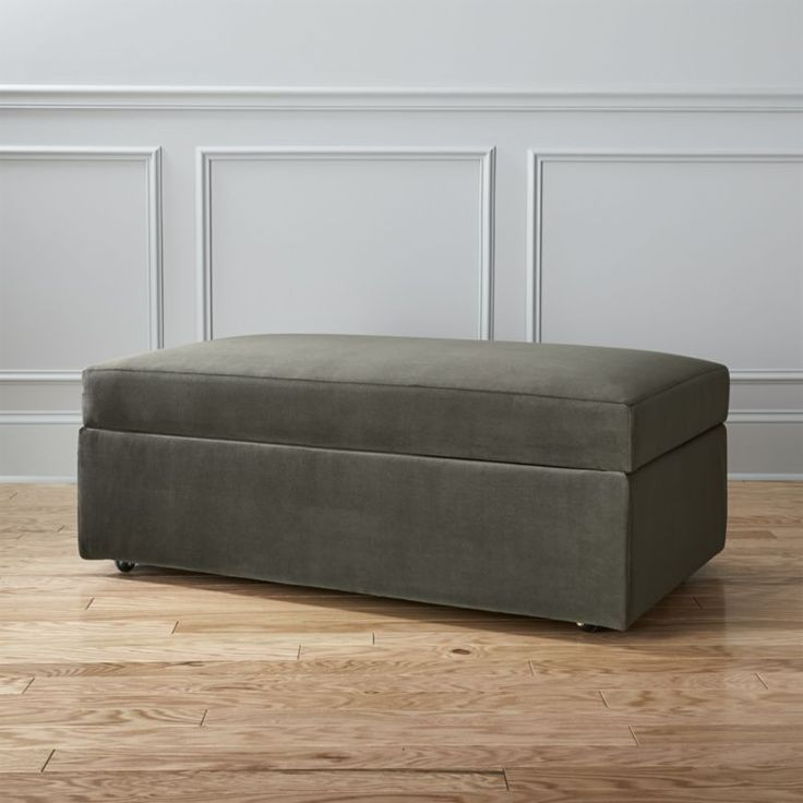 Shop movie storage ottoman.   The perfect trailer to our movie sleeper sofa.  Tailored to match inside and out in tweedy poly weave, extra seat/footrest hinges open to stash blankets and bedding for overnight guests.