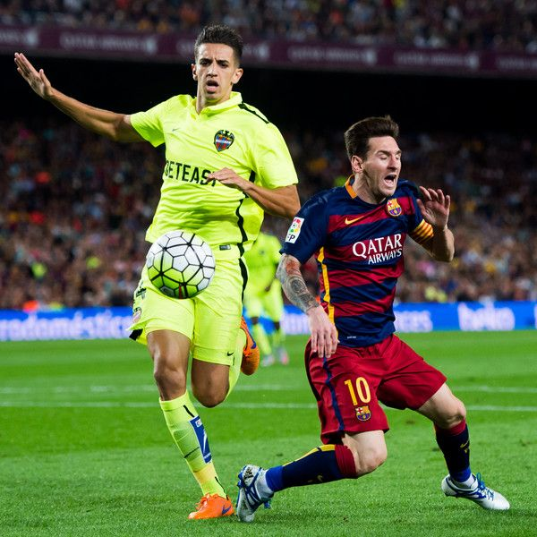 Lionel Messi of FC Barcelona is fouled inside the penalty area by Zouhair 'Zou' Feddal during the La Liga match between FC Barcelona and Levante UD at Camp Nou on September 20, 2015 in Barcelona, Catalonia.