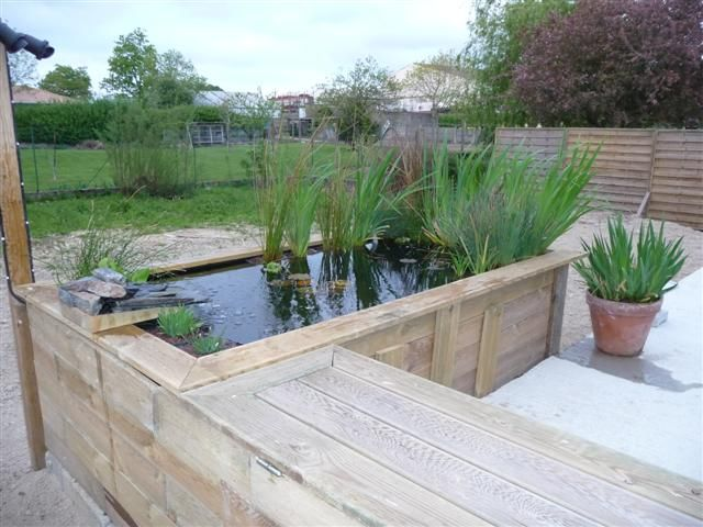 Un projet en bout de terrasse do it yourself jardin for Bassin poisson exterieur