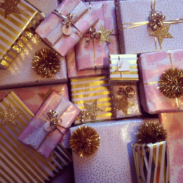 Gold and pink christmas wrapping with stripes and dots and tinsel and glitter