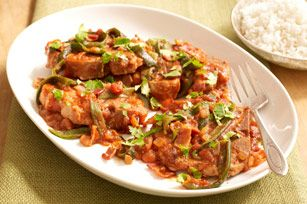 Saucy Spiced Pork Chops. Bone-in pork chops get dressed up in this spicy-smoky sauce made with poblano chiles and bacon.