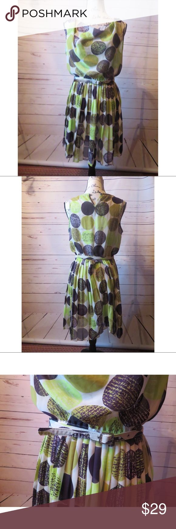 "Banana Republic Green Polka Dot Dress Size 6 Banana Republic Womens 6 Shirt Dress Green Sleeveless Polka Dot with Belt  Gently Used Great Condition  Stretchy  Some Fraying of the Material  Machine Wash Sleeveless  Size 6 Made in the Philippines   Material: 100% Polyester   Measurements Length: 36"" Bust: 32"" Waist: 24"" stretch  Hips: 38.5"" Banana Republic Dresses Midi"