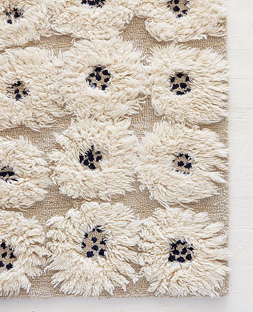 Take a step onto this rug of extra-plush handtufted blooms, and its cushiony texture will have you staying awhile. Joyously modern outlook + the cozy comfort kids love best. <br>