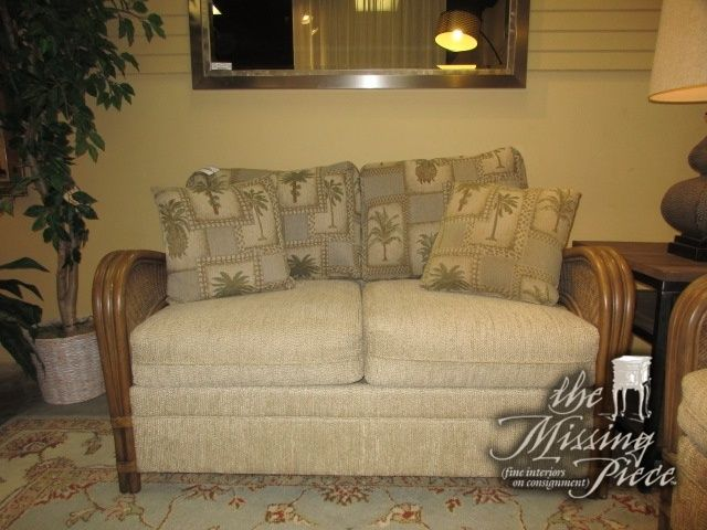 """Tropical style loveseat in a tan upholstery with palm print accent pillows set on medium rattan frame. Nice piece for a Florida style home. At posting, we have the matching sleeper sofa. 55""""L x 35""""D x 36""""H."""