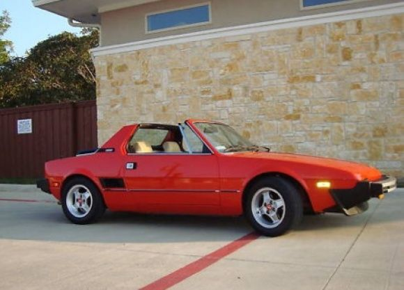 My 1st car...a used Fiat X19.  My father paid 1/2, I paid 1/2.  I was on cloud 9.  (Pic is not of my actual car)
