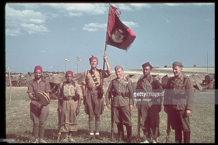 Two German soldiers of the Condor Legion (at right and third right) pose with…
