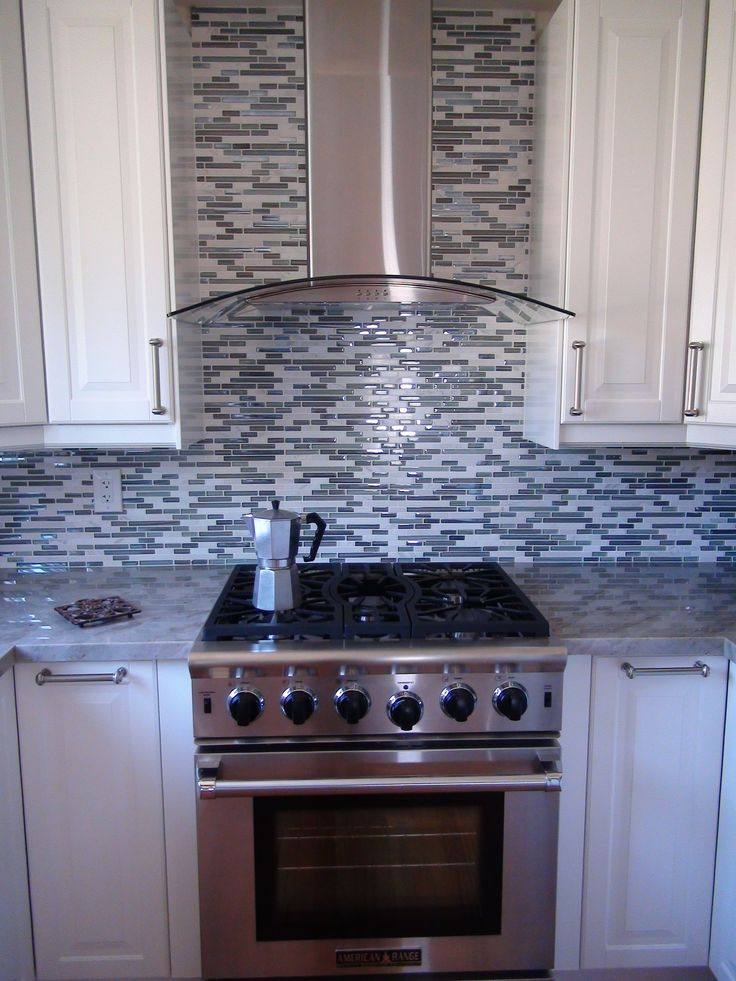 Delightful Stove By American Range, Hood By Proline Range Hoods, Backsplash By Elysium  Milano Glass Mosaic Tile In Blue, Cabinets By Ikea, Counters In Sea Pearl  ...