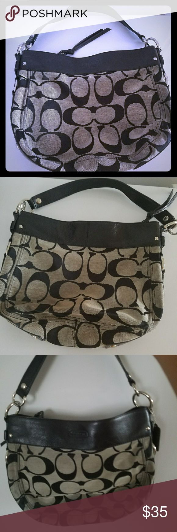 Coach Handbag Used Coach hobo style handbag with Leather trim. Medium size. Some stains are on the back of the purse. Inside has 3 pockets to hold cell phone, if or compact mirror. Coach Bags Hobos