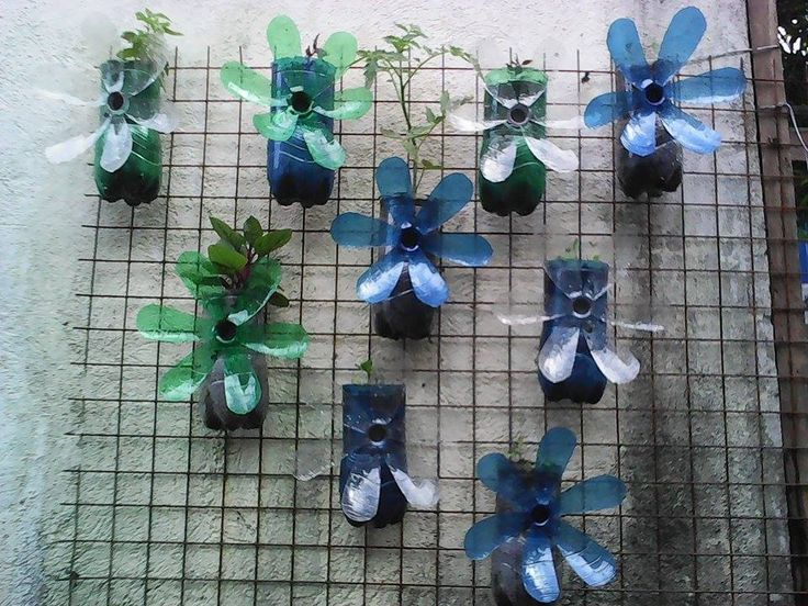 "Recycled Vertical Bottle Garden made at Marty's Garden Philippines by Lehra ""Imelda"". More designs on the way!"