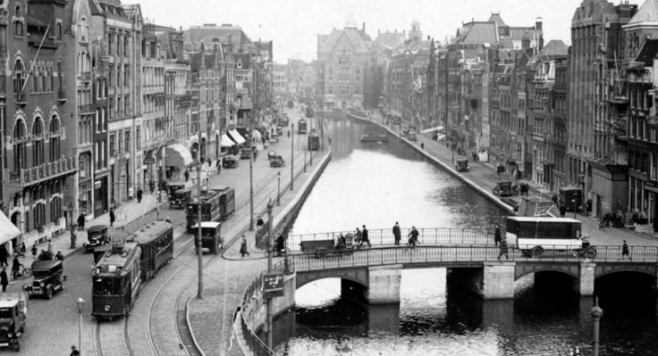 1935-1940. View on the Rokin in Amsterdam. The Rokin is a major street in the center of Amsterdam. Originally it was part of the river Amstel. The Rokin begins at Muntplein and ends at the Dam. In 1936, the part between Spui Square and the Dam was filled in. On the remaining part of the water, canal touring boats are now moored. Photo Serc. #amsterdam #1940 #Rokin
