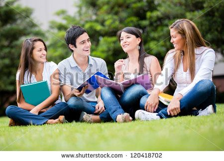 Happy group of students sitting at the park talking - stock photo