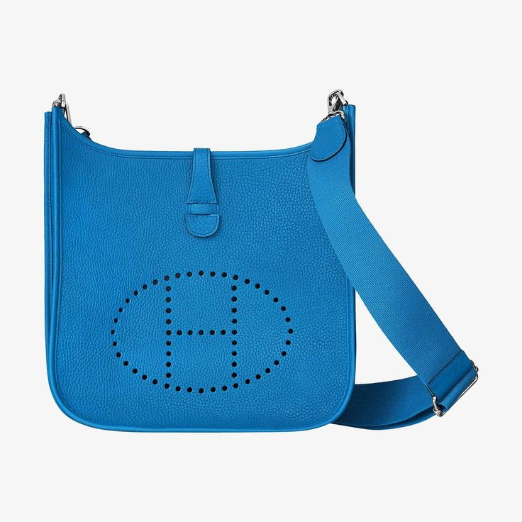 Hermes shoulder bag in taurillon Clemence leather Perforated leather plaque, outside pocket and leather tabclosure Palladium plated hardware Bleu Zanzibar