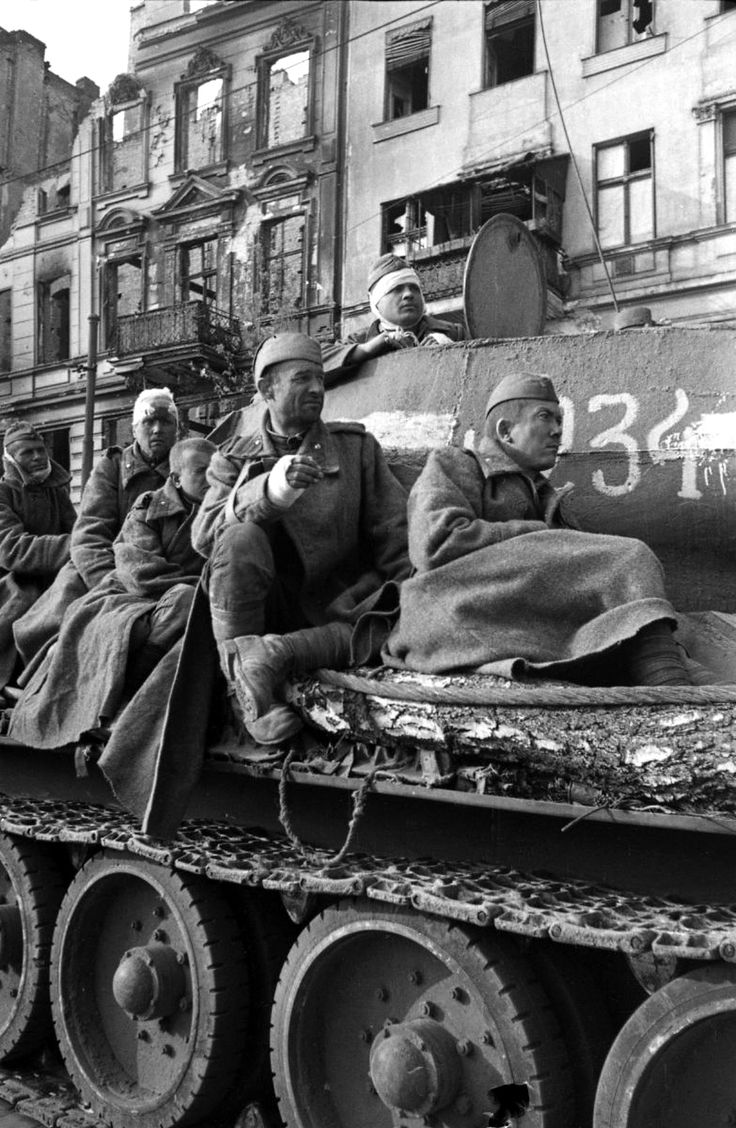 Injured Soviet soldiers rest on a Soviet T-34 85 medium tank during the last throes of the Battle of Berlin. Beginning on 12 January 1945, the Soviets breached the German front as a result of the Vistula-Oder Offensive and advanced westward as much as 40 km (25 miles) a day through East Prussia, Lower Silesia, East Pomerania and Upper Silesia, temporarily halting on a line 60 km (37 mi) east of Berlin along the Oder river. When the offensive resumed, two Soviet fronts attacked Berlin from…