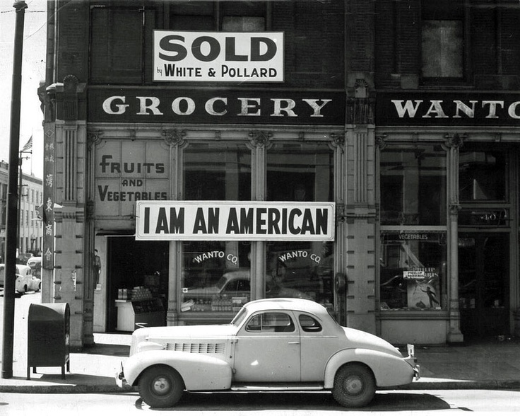 Japanese American Grocer by Dorothea Lange