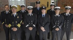 Newly promoted members of the Fall River Fire Department pose together Wednesday evening. Front row, from left, are Fire Chief William Silvia, District Chief Scott Flannery, Lt. Kenneth Perry, Capt. Jason Poissant and Capt. Michael Cabral. Back row, from left, are Deputy Chief William Joaquim, Capt. Sean Flannery, Lt. Michael Baldi and District Chief Ambrose Smith. Jul 2012.