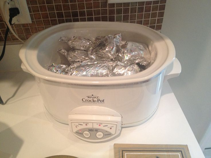 Perfect for game day, tail gates etc. Assemble hot dogs in buns then wrap in foil. Sandwiches too. Set crock pot on low.  Now you have warm sandwiches all day!