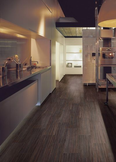 Brown imperial tile floor - Academy Tiles | Richmond, Melbourne  - this is a very slick looking kitchen.
