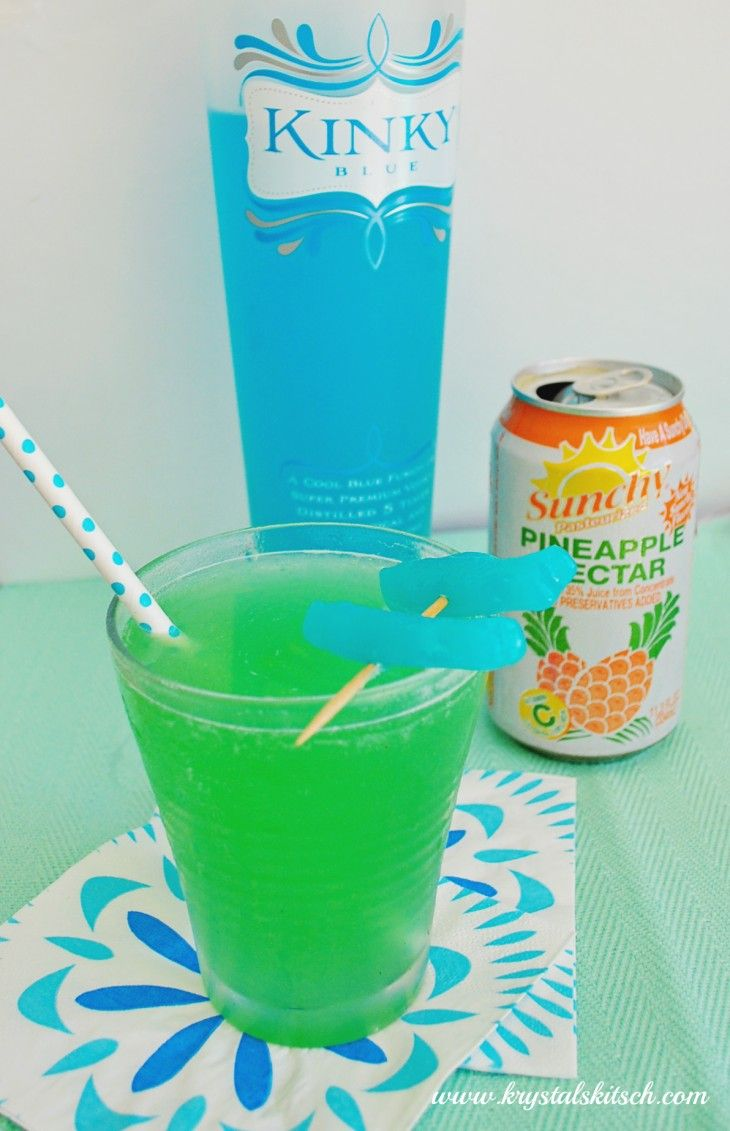 Bright Blue Liquer, Coconut Rum, and Pineapple Nectar make one beachy, shark-week inspired cocktail. Get the recipe from Krystal's Kitsch.   - Delish.com