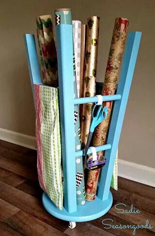Use an old stool for wrapping paper holder