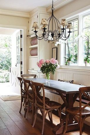 Cottage Dining Room with Crown molding, Chandelier, Wrought iron chandelier with shades, Custom built-in bench seating, Paint