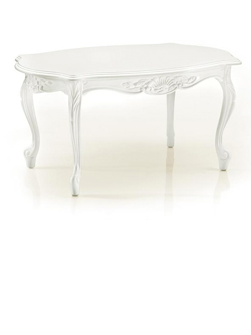 The Small Baroque white rectangular coffee table is carved from solid beech wood with a white lacquered finish.