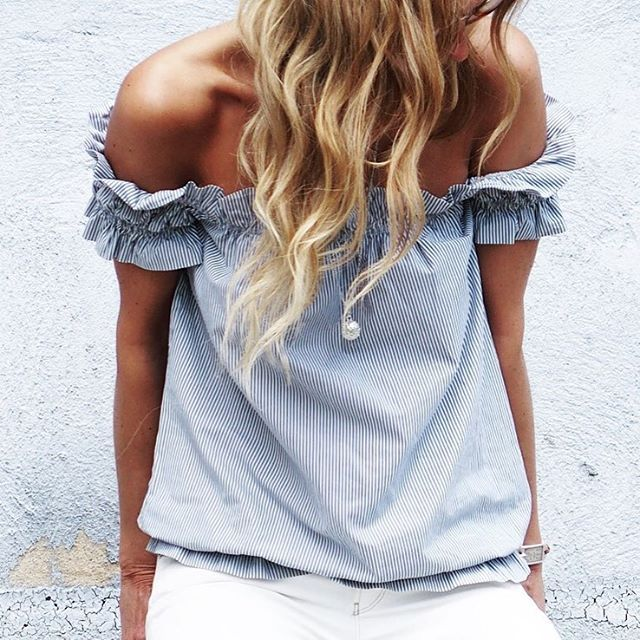 Off-shoulder summer style in light blue.
