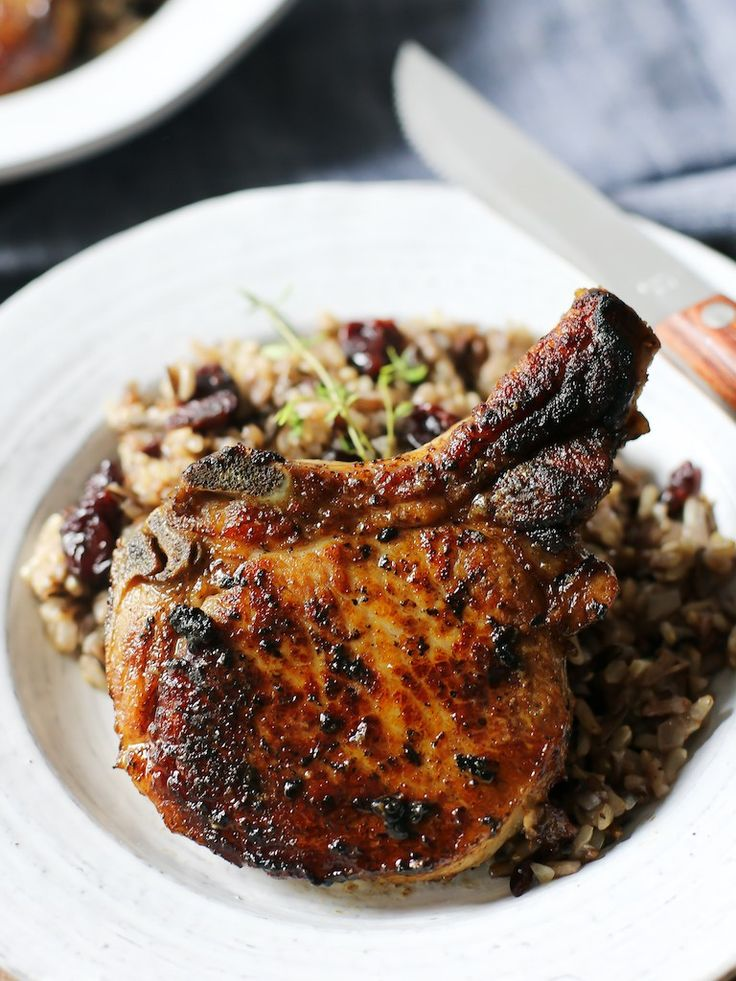 Pan-Roasted, Brown Butter-Basted Pork Chops over Wild Rice with Dried ...