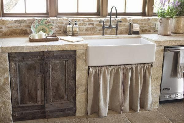 """A Rustic """"Upscale French Barn"""" House in Texas on Possum Lake in Texas.    French Barn Kitchen - The bulls head panel in the kitchen is from a French butcher shop.  The kitchen counter tops used to be floors in a cathedral.  Old Italian shutters were used for the cabinet doors.      Photos by Ross Hailey - If you want to see lots more photos and get more information please visit: Indulge"""