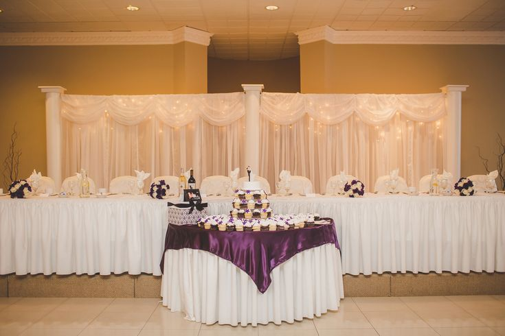 Head table & cake table with purple overlay and twinkly light backdrop #WeddingDecor