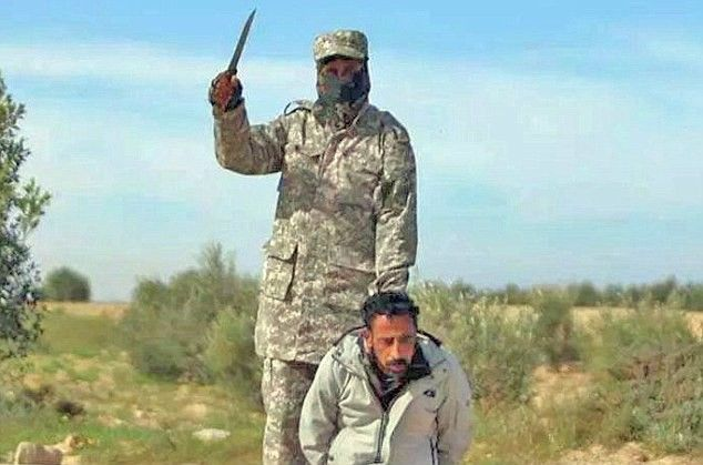 Daesh Flex their muscles in Egypt's Sinai by releasing pictures of two accused men executed in Sinai of spying for the Egyptian army.