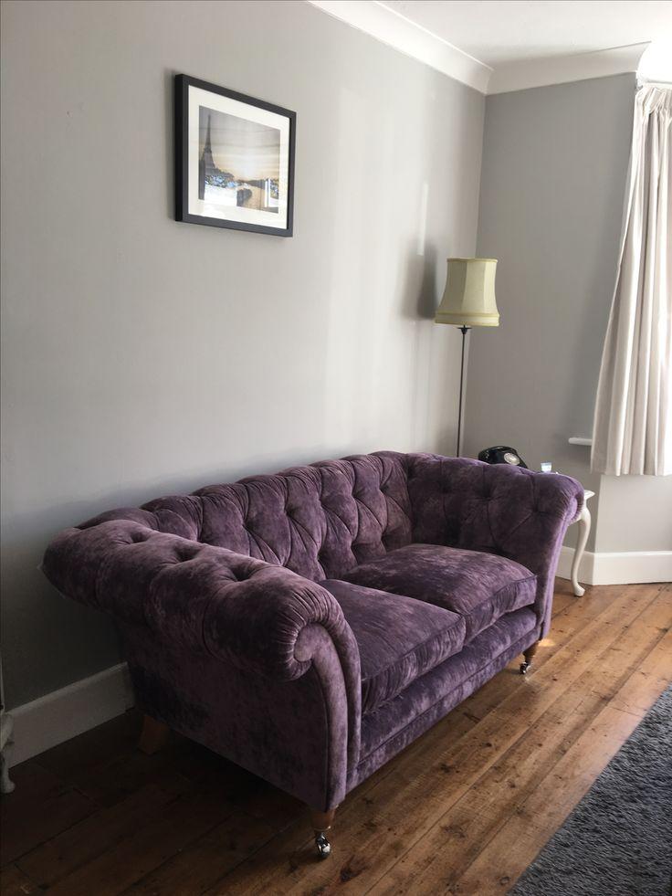 Walls painted in pavilion grey Farrow & Ball, velvet sofa from Laura Ashley