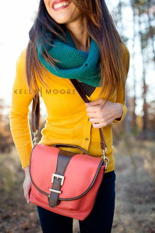 This combination of a yellow cardigan and navy skinny jeans is perfect for off-duty occasions.  Shop this look for $64:  http://lookastic.com/women/looks/scarf-and-crew-neck-t-shirt-and-cardigan-and-crossbody-bag-and-skinny-jeans/3952  — Teal Scarf  — Charcoal Crew-neck T-shirt  — Yellow Cardigan  — Hot Pink Leather Crossbody Bag  — Navy Skinny Jeans