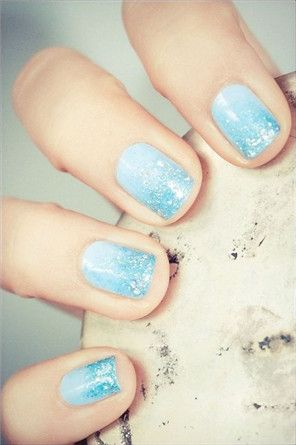 pale blue nails with subtle blue glitter tips