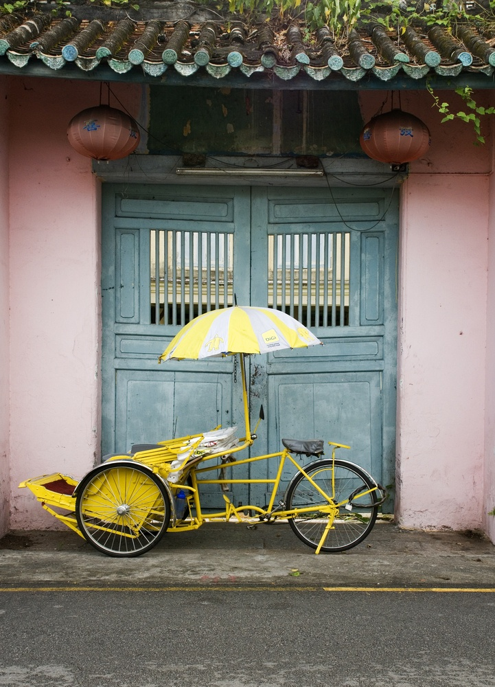 Trishaw against doorway, Malaysia.. rode in trishaws in Melaka in 2010 with the Capt.. frommers.com