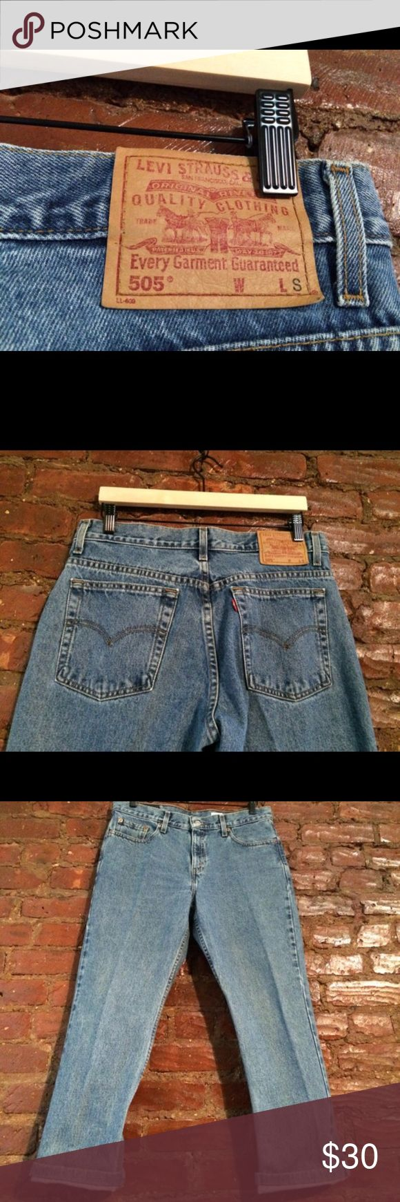 1990's Vintage Levi 505 Jeans Awesome baggie boyfriend 1990's Vintage Levi 505 Jeans. They have a zipper and one bottom on the top.    Material: Jean   Tags: Levi  Size: size 34 with short length (look at measurements down below)  Condition: Everything good except right bottom leg has a small hem (reference to photo for size)  Flat Measurements: Waist- 16' Hip- 18 1/2' Length- 36' Leg bottom width: 7 3/4'  *If you have any questions feel free to contact me ! Jeans Boyfriend