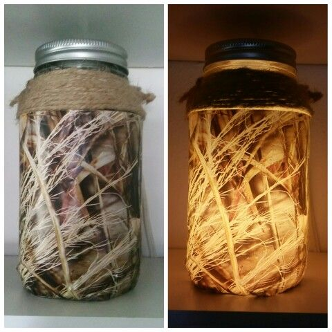 Twine, camo wrapping paper, mason jar and old light. Great for a boy's night light.