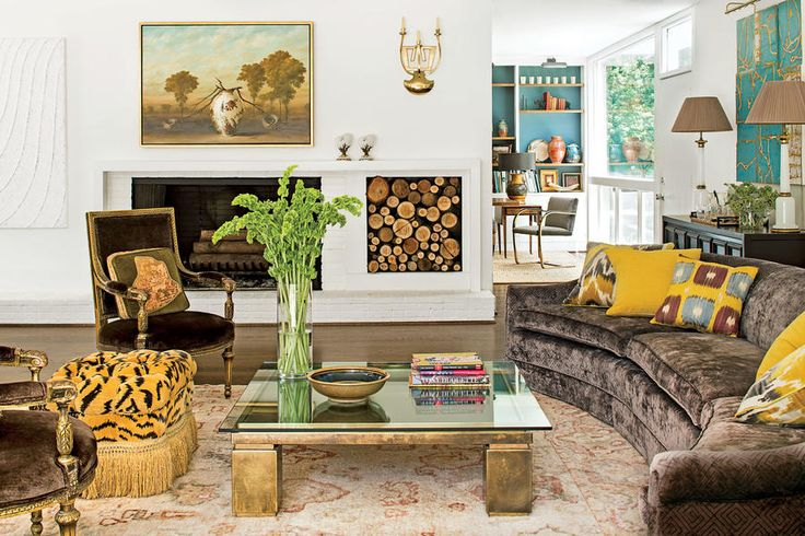 Mix Mod and Traditional - 108 Living Room Decorating Ideas - Southernliving. The 11-foot-long vintage sofa in this living room is a mod counterpoint to a pair of traditional antique chairs.