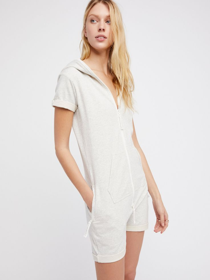 Fitted Short Jumpsuit | Comfy and cool hooded jumpsuit featuring a front zipper closure with front athletic-inspired pocket details and side zipper compartments.    * Rolled sleeve cuffs and hem for a relaxed look * Ultra soft and stretchy fabrication for easy, all-day wear * Front embroidered One Piece logo