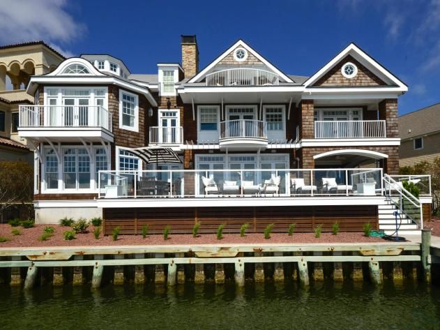 Waterfront homes bayfront cape cod in ocean city md for Cape cod waterfront homes for sale