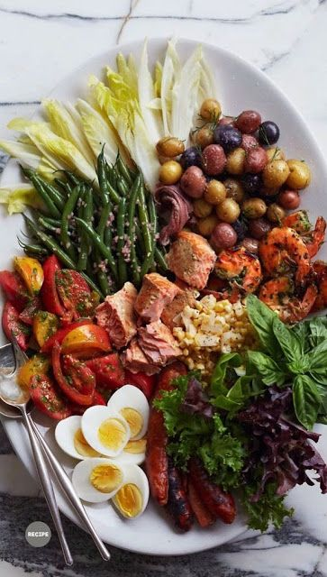 Antipasto platter assorted olives, smoked salmon, roasted peppers ...