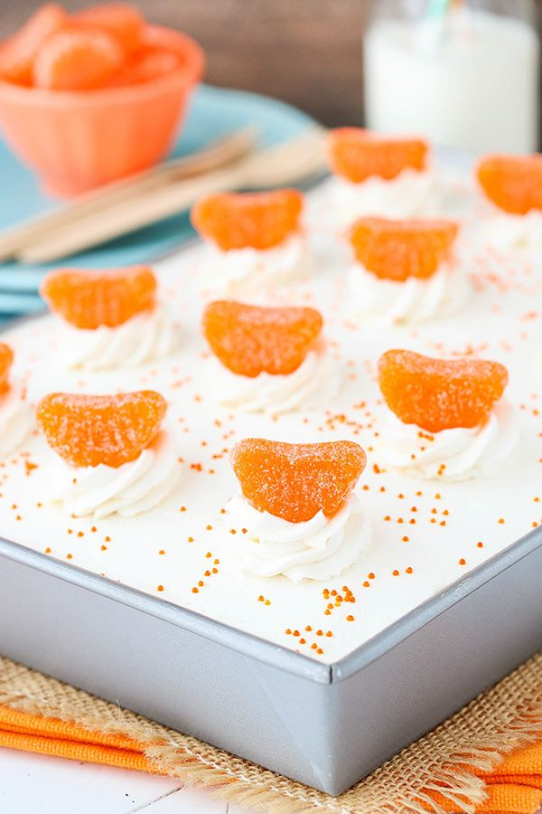 Orange Creamsicle Poke Cake - a moist, from-scratch vanilla cake soaked with orange JELLO and topped with whipped cream!   | Life, Love & Sugar